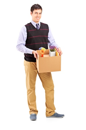 Full length portrait of a young male holding a moving box isolated on white background Stock Photo - 16986297