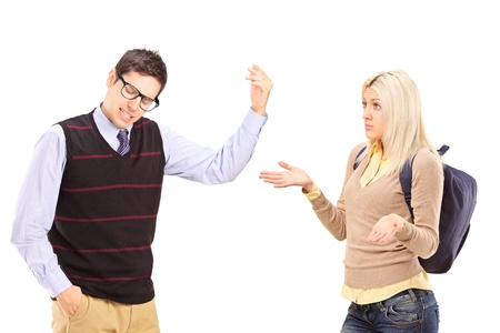 people arguing: Young male and female student arguing isolated on white background