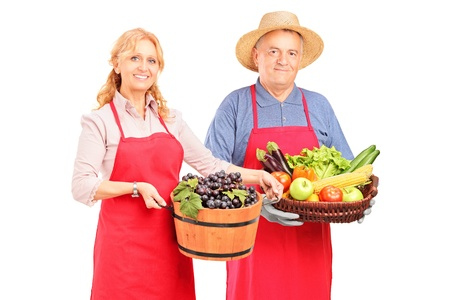 brinjal: Male and female gardeners with basket of fruit and vegetables isolated on white background