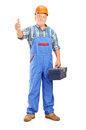 Full length portrait of a manual worker holding tool box and giving a thumb up isolated on white background Stock Photo - 17098863