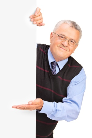 Gentleman posing behind a blank panel and gesturing isolated on white background photo