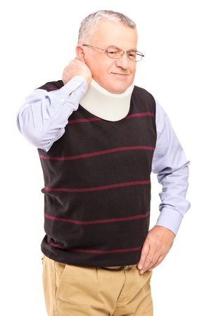senior man on a neck pain: An injured mature man with neck holder suffering from a pain isolated on white background
