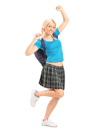 Full length portrait of an excited female student with raised hands isolated on white background Stock Photo - 17052569