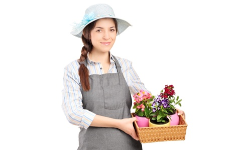A female gardener holding flower plants isolated on white background photo