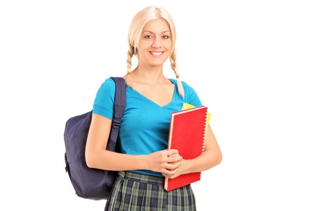 A female student standing with school bag and holding books, isolated on white background Stock Photo - 17130874