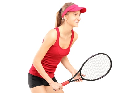 A female tennis player ready to play isolated on white background photo