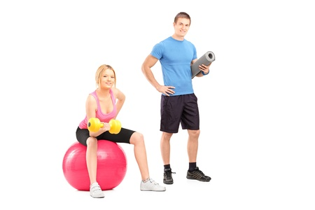 A male and female athletes with equipment posing isolated on white background photo