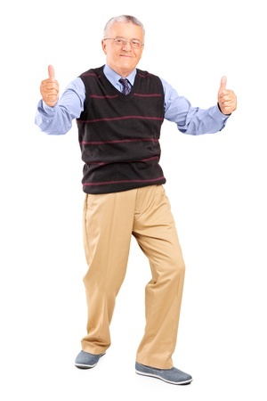 posing  agree: Full length portrait of a gentleman giving thumbs up isolated on white background Stock Photo