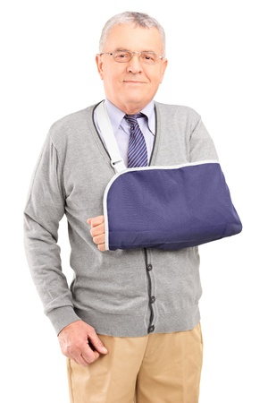 A senior man with broken arm posing isolated on white background photo
