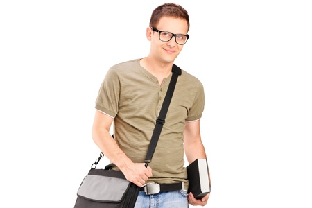 A male student with shoulder bag holding a book isolated on white background photo