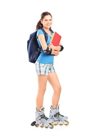 inline skater: Full length portrait of a female student on roller skates isolated on white background Stock Photo