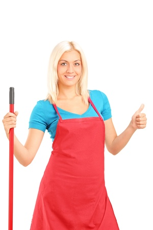 Smiling female cleaner giving a thumb up isolated on white background Stock Photo - 17321366