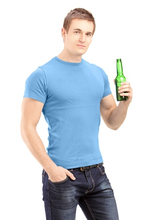Young handsome man holding a bottle of beer isolated on white background photo
