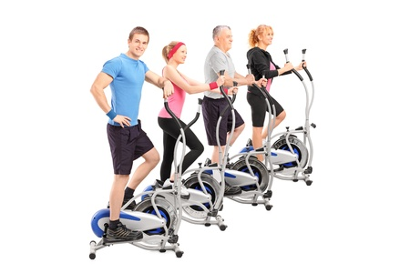 flywheel: A group of people working on a cross trainer machine isolated against white background