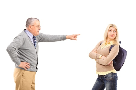 man scolding: Angry father reprimanding his daughter isolated on white background