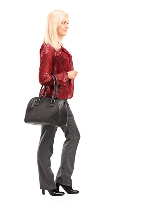 purse: Full length portrait of a blond woman standing isolated on white background