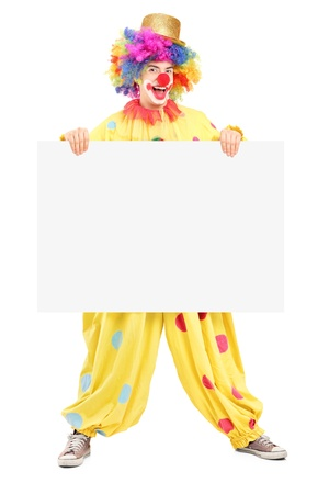 blank expression: Full length portrait of a male clown with happy joyful expression holding a blank panel isolated on white background Stock Photo
