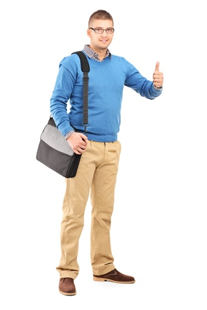Full length portrait of a young man with a shoulder bag giving a thumb up isolated on white background Stock Photo - 17333917