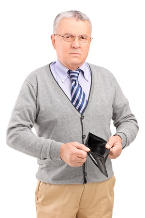 Senior man holding an empty wallet isolated on white background  photo