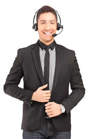 A handsome male customer service operator wearing a headphones and microphone isolated on white background photo