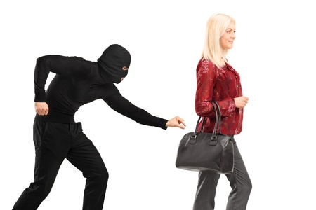 stealer: A pickpocket with mask trying to steal a from a woman carrying a purse isolated on white background
