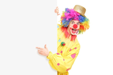 Funny circus clown posing behind a blank panel isolated on white background Stock Photo - 17368124