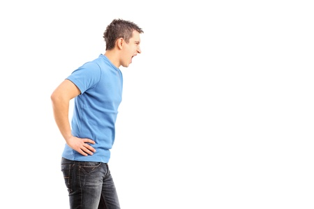 Young agrresive man shouting isolated on white background Stock Photo