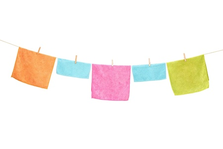 wash cloth: Clothes hanging on a line, isolated on white background Stock Photo