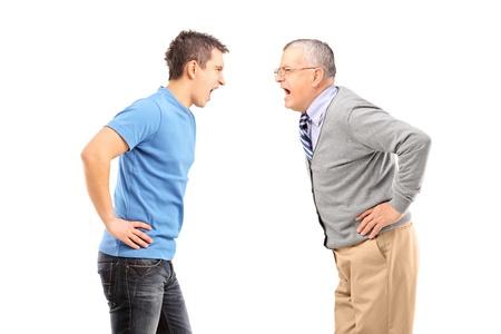 conflicto: Angry padre e hijo que tienen un argumento, aislados en fondo blanco Foto de archivo