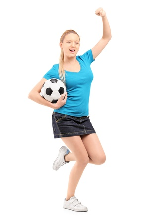 euphoric: Full length portrait of a happy female holding football and cheering isolated on white background
