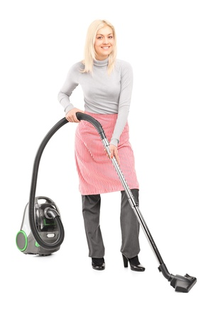 hover: Full length portrait of a woman cleaner with hover isolated on white background Stock Photo