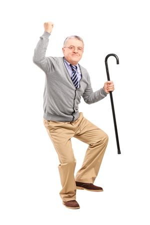 1 mature man: Full length portrait of a happy senior man holding a cane and gesturing happiness isolated on white background Stock Photo