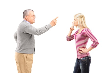 Father reprimending his daughter isolated on white background Stock Photo - 17506574