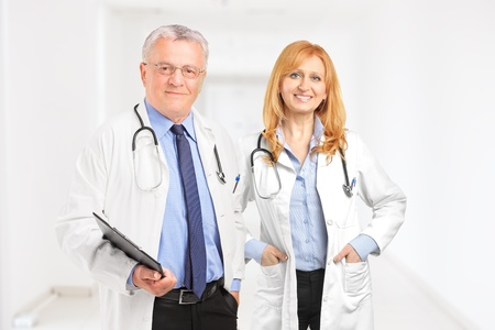 Male and female doctor standing in a hall of a clinic photo