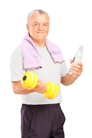 A mature man exercising with a dumbbell and holding a bottle of water isolated on white background photo