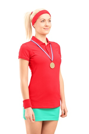 Winner female tennis player with a golden medal standing isolated on white background Stock Photo - 17535245