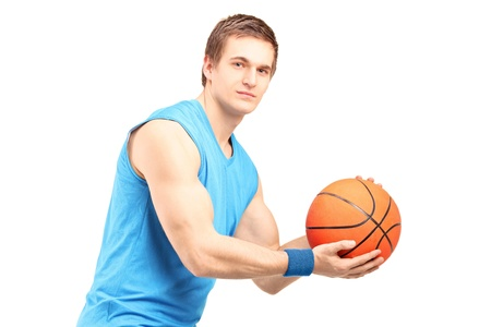 A male basketball player with basketball looking at camera isolated on white background photo