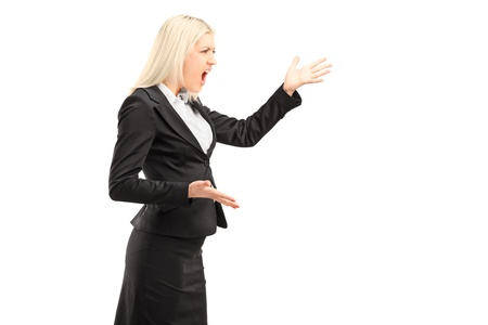 A nervous businesswoman shouting isolated on white background Stock Photo - 17591059