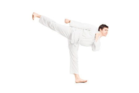 A karate man exercising isolated against white background Stock Photo - 17591051
