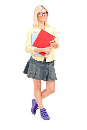 Full length portrait of a female student holding books isolated on white background Stock Photo - 17591045
