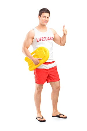duty: Full length portrait of a happy lifeguard on duty giving a thumb up isolated on white background