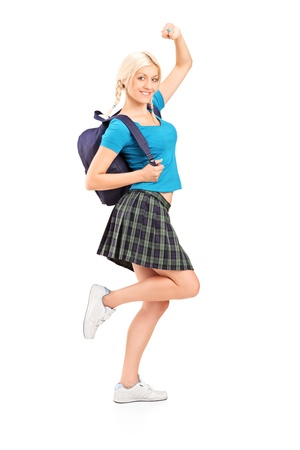 Full length portrait of an excited young female student with raised hands isolated on white background Stock Photo - 17591048