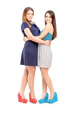 frienship: Full length portrait of two female best friends isolated on white background