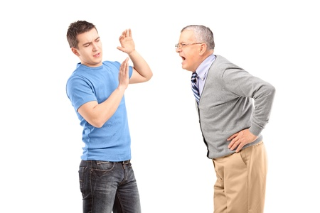 Mature man yelling at a young man isolated on white background Stock Photo - 17638684