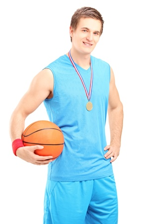 Winner basketball player posing with a golden medal isolated on white background photo