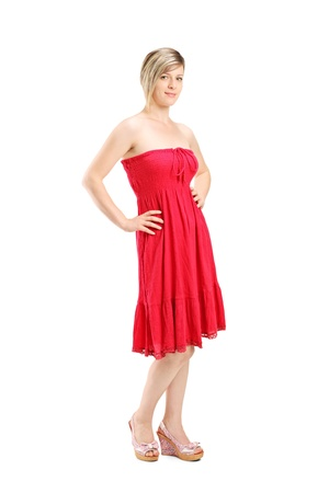 Full length portrait of a young woman posing in a red dress isolated on white background photo