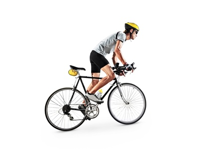 cycling   helmet: A male bicyclist riding a bike isolated on white background Stock Photo