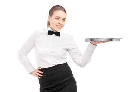 A waitress with bow tie holding an empty tray isolated on white background photo