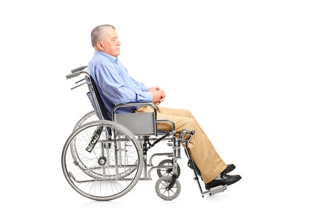 paraplegia: A disabled senior man posing in a wheelchair isolated on white background