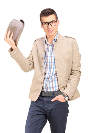 A young man holding a hat isolated on white background Stock Photo - 17784743